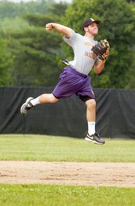 Saratoga Central Catholic Saints Dale Long warms up passing the ball to first base in the air as coach Fonzie Lambert hits ground balls during practice Thursday afternoon. Photo Erica Miller 6/9/11 spt_SpaCathPrac3_Sat