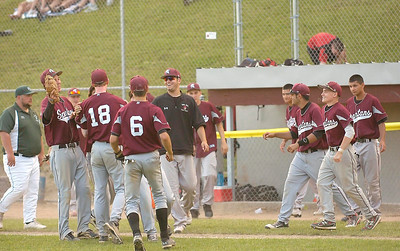The Burnt Hill-Ballston Lake High School Spartans celebrate their Class A regional win over Franklin Academy of Malone Tuesday at Bleeker Stadium in Albany. Ed Burke 6/7/11