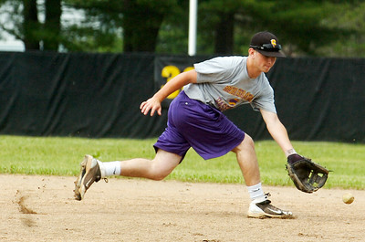 Saratoga Central Catholic Saints Billy McDonough warms up as coach Fonzie Lambert hits ground balls during practice Thursday afternoon. Photo Erica Miller 6/9/11 spt_SpaCathPrac2_Sat