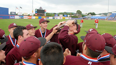 Burnt Hills-Ballston Lake Baseball teammates celebrate after their State Championship win against Pittsford Surtherland in Binghamton Sunday afternoon. Photo Erica Miller 6/12/11 spt_BHBLwin3_Mon