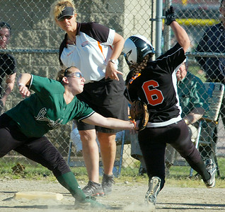 Shen's Katie Traver tags out Bethlehem runner Cassie Smith as she tries to make it to third during Friday's Class AA softball championship at Clifton Common. Ed Burke 6/3/11