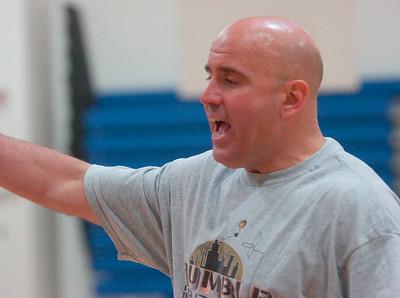 Saratoga's new varsity basketball coach Frank Mahoney runs drills Thursday for returning varsity players. Ed Burke 6/23/11