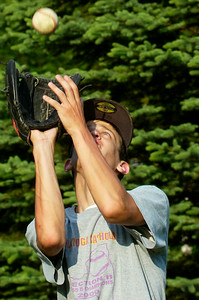 Saratoga Central Catholic Saints Varsity Baseball outfielder Brad Scammell catches flyballs during practice Monday evening before their Regional game against Potsdam at St. Lawrence on Tuesday. Photo Erica Miller 6/5/11 spt_SpaCathPrac4_Tues