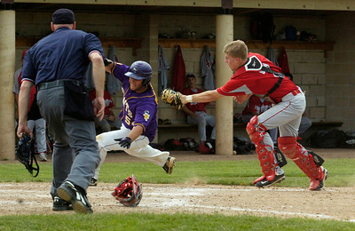Saratoga Central Catholic Saints Chris Pescetti slides safely into home plate as Chenango Valley's catcher Mike Fernald tries to tag him during their State Semifinals at Binghamton University Saturday afternoon. Photo Erica Miller 6/11/11 spt_SpaSTATES3_Sun