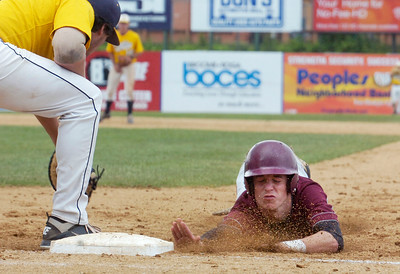 Burnt Hills-Ballston Lake's Schuyler Meyers slides safely back to first base with Pittsford Surtherland's Zach Salvia on first base during their winning State Championship baseball game in Binghamton Sunday afternoon. Photo Erica Miller 6/12/11 spt_BHBLwin4_Mon