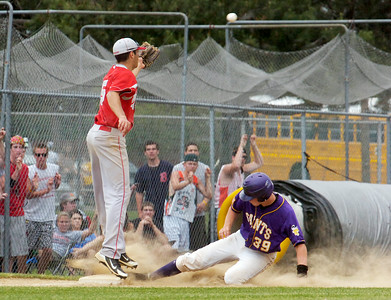 Saratoga Central Catholic Saints catcher Jack Keller slides safely into third base as Chenango Valley's Robert Heller waits for the baseball during their State Semifinals at Binghamton University Saturday afternoon. Photo Erica Miller 6/11/11 spt_SpaSTATES5_Sun