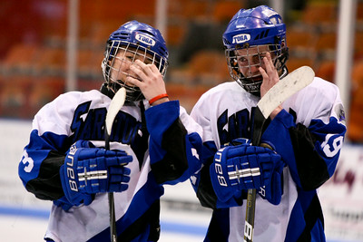 Saratoga's Jamie Bartoszek (left) and Mike Laymen (right) react after losing to Williamsville North 3-2 during the NYS High School Boys State Ice Hockey Division 1 Championship at Memorial Auditorium in Utica, NY. Nick Serrata