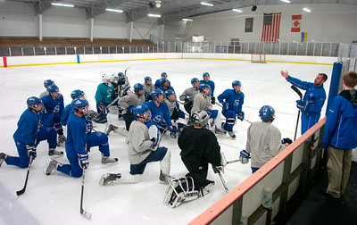 Blue Streaks coach Mike Ricupero talks to his team during Friday's practice before heading to Utica this weekend to compete for a state championship. Ed Burke 3/11/11