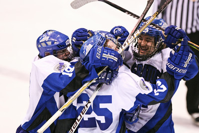 (center) Saratoga Springs - Luke Fauler Players celebrated Alex Luse (hidden) goal in the 3rd period. Saratoga defeated Greece 1-0 during the NYS Ice Hockey State Championship Division 1 at Memorial Auditorium in Utica, NY. Nick Serrata