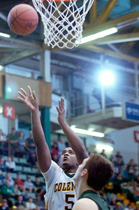 Coleman Catholic High School's Chris Chatelain makes shot at the basket during their winning basketball game against Finney High School Friday afternoon at the Glens Falls Civic Center. Photo Erica Miller 3/18/11 spt_Coleman3