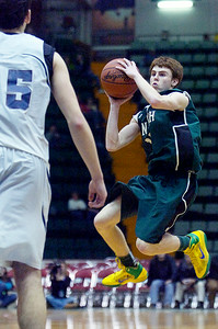 Greenwich's Joe Estramonte takes a shot at the basket during their Class C semi-final basketball game against Syracuse Academy of Science Friday afternoon at the Glens Falls Civic Center. Photo Erica Miller 3/18/11 spt_Greenwich1_Sat