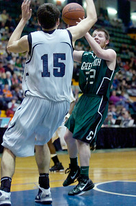 Greenwich's Jason Flynn takes a shot at the basket guarded by Syracuse Ahmet Tunali during their Class C semi-final basketball game Friday afternoon at the Glens Falls Civic Center. Photo Erica Miller 3/18/11 spt_Greenwich3_Sat