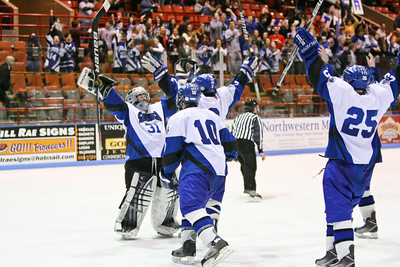 Saratoga's goaltender (31) Ryan Bourgeois celebrates with his teammates (10) Brendon Wormley, (2) Alex Luse (hidden), and (25) Luke Fauler after the game. Saratoga defeated Greece 1-0 during the NYS Ice Hockey State Championship Division 1 at Memorial Auditorium in Utica, NY. Nick Serrata