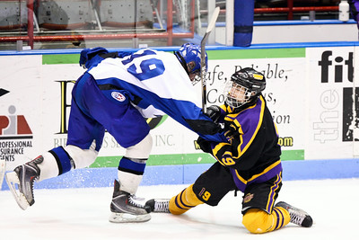 (left) Saratoga Springs - Mike Layman (right) Greece - Justin Simonelli Players play tug a war during the 2nd period. Saratoga defeated Greece 1-0 during the NYS Ice Hockey State Championship Division 1 at Memorial Auditorium in Utica, NY. Nick Serrata