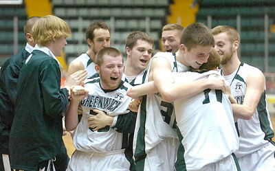Greenwich varsity basketball players celebrate their Sectional win over Lake George Saturday at the Glens Falls Civic Center. Ed Burke 3/5/11