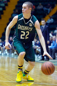 Greenwich's Josh May dribbles the ball down the court during their Class C semi-final basketball game against Syracuse Academy of Science Friday afternoon at the Glens Falls Civic Center. Photo Erica Miller 3/18/11 spt_Greenwich4_Sat