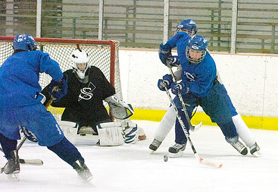 The Blue Streaks practice Friday at saratoga Springs Ice Rink for the state finals in Utica. Ed Burke 3/11/11