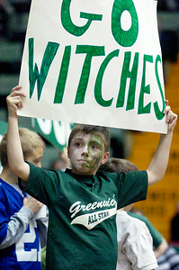 Greenwich basketball fan Chris Albrecht, 9 years old, holds his sign supporting the team as they compete against Syracuse Academy of Science Friday afternoon at the Glens Falls Civic Center. Photo Erica Miller 3/18/11 spt_Greenwich6_Sat