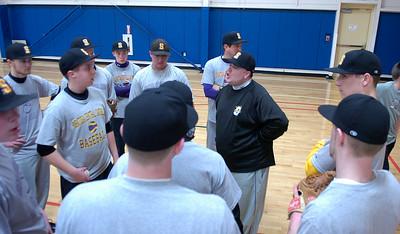 Saints coach Alphonse Lambert Jr. talks to his team during an indoor practice Tuesday evening at Saratoga Springs Recreation Center. Ed Burke 3/6/12