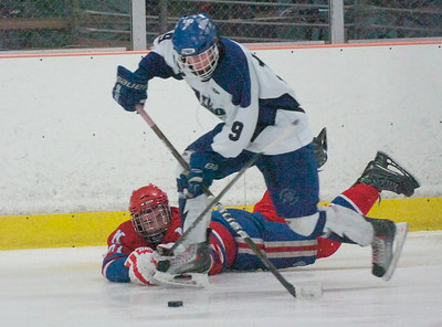 Saratoga's Mike Layman gets the upper hand on a play with Massena's Jake Holcomb during the hockey regional playoff Saturday at Saratoga Springs Ice Rink. Ed Burke 3/3/12