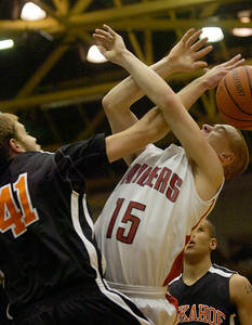 Tuckahoe's Mark Raymond gets the block on an attempt by Mechanicville's Ryan McBride during Friday's Class C state semifinal matchup at the Glens Falls Civic Center. Ed Burke 3/16/12