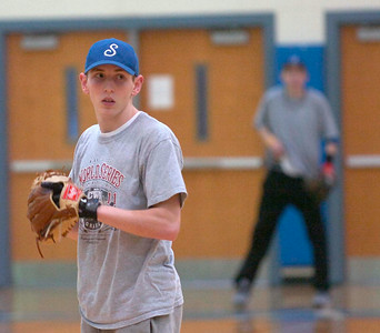 Saratoga's Casey Kerr takes the mound Thursday during indoor practice in the gym at Saratoga Springs High School. Ed Burke 3/8/12