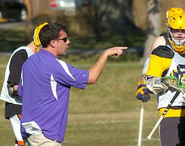 Ballston boys varsity lacrosse coach Joe Pollicino talks with his team. Ed Burke 3/21/12