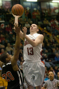Mechanicville's Jordan McBride shoots over Tuckahoe defender Shyheim Nixon during Friday's Class C state semifinal game at he Glens Falls Civic Center. Ed Burke 3/16/12