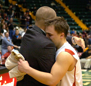 Player Sam DeCelle gets an embrace from assistant coach Matt Ramnes after receiving the Sportsmanship Award for Mechanicville after their loss to Tuckahoe Friday in Glens Falls. Ed Burke 3/16/12
