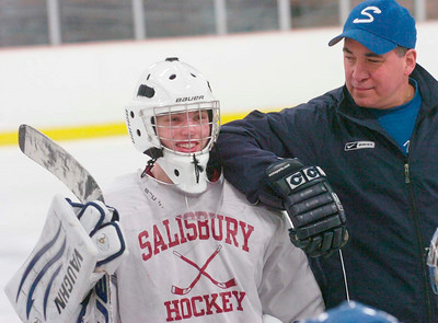 Blue Streak coach Dave Torres jokes with goalie Spencer Glaim during Thursday's practice at Saratoga Springs Ice Rink. Ed Burke 3/8/12