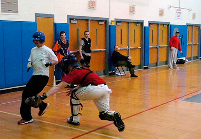 Catcher Zach Forbes tags runner Logan Kurtz during the Blue Streak's indoor practice in the gym at saratoga Springs High School. Ed Burke 3/8/12
