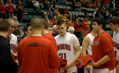 The Red Raiders reflect on their Class C state semifinal loss to Tuckahoe Friday night at the Glens Falls Civic Center. Ed Burke 3/16/12