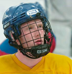 Saratoga's Brett Merriman listens during Thursday's practice at Saratoga Springs ice Rink. Ed Burke 3/8/12