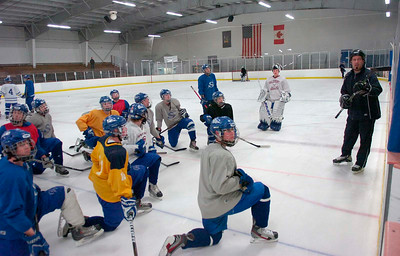 Assistant coach Tim Grande talks to the team during Thursday's practice at Saratoga Springs Ice Rink. Ed Burke 3/8/12
