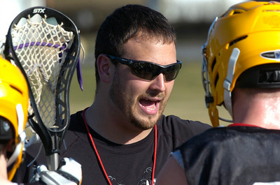 Ballston Spa assistant varsity lacrosse coach Andy Smith talks with team members during Wednesday's practice. Ed Burke 3/21/12