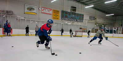 The Blue Streaks run their drills during practice Thursday at Saratoga Springs Ice Rink. Ed Burke 3/8/12