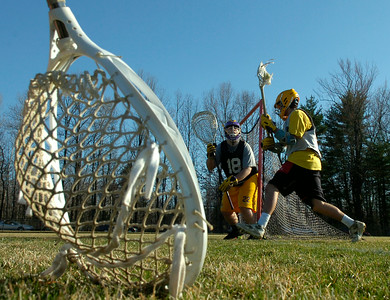 Goalie Wayne Van Valkenburgh protects the net during practice Wednesday at Ballston Spa High School. Ed Burke 3/21/12