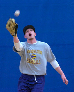 Saints' Matt Boyark fields a soft flyball during indoor practice Tuesday at Saratoga Springs Recreation Center. Ed Burke 3/6/12