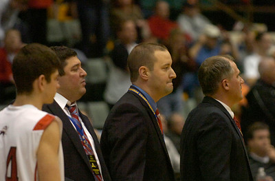Mechanicville coach Rian Richardson, center, watches the Red Raiders season come to an end Friday at the Glens Falls Civic Center. Ed Burke 3/16/12