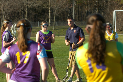 Ballston Spa girls varsity lacrosse coach Don Nowc works with his team Wednesday. Ed Burke 3/21/12