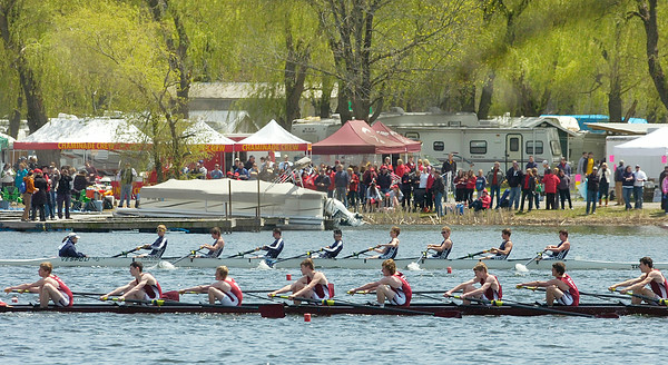 A Saratoga Men's Lightweight 8 boat, back, and Fordham Prep compete in Saturday's Saratoga Invitational on Fish Creek. Ed Burke 4/28/12