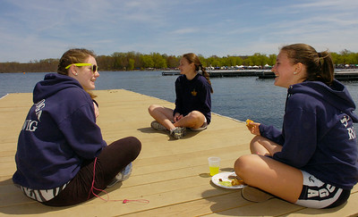 Saratoga Freshman rowers relax on a dock near their boathouse Saturday during the Saratoga Invitational. From left: Fiona Casey, Katrina Rench and Jess Sharpe. Ed Burke 4/28/12