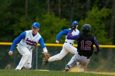 Ballston Spa's Dylan Prehoda slides safely into second base as Brett Merriman tried to catch the ball during their baseball game in Ballston Spa. Photo Erica Miller 4/30/12 spt_Baseball3_Tues