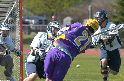 Ballston Spa's Mark Leslie fires a shot on goal between Saratoga defenders Brendan Wormley and Zach Samach, right, during saturday's varsity lacrosse matchup at Saratoga. Ed Burke 4/28/12