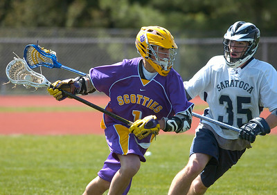 Saratoga's Ben Ketcham pressures Ballston Spa's Sam Groves suring Saturday's varsity lacrosse game at Saratoga. Ed Burke 4/28/12
