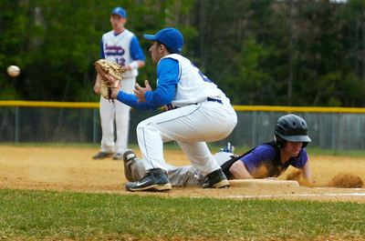 Ballston Spa's Nick Van Liew slides safely back into first base as first baseman Saratoga's Wellman Louiza catches the ball during their baseball game in Ballston Spa. Photo Erica Miller 4/30/12 spt_Baseball4_Tues