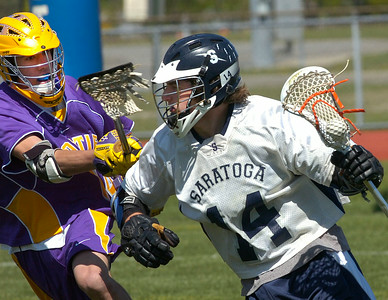 Saratoga's Ben Cumming is pressured by Ballston Spa defender Kyle Abdellatif during Saturday's varsity lacrosse matchup at Saratoga. Ed Burke 4/28/12