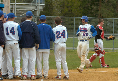 The Blue Streaks welcome home teammate Zach Forbes after his fourth inning home run against Glens Falls Friday at East Side Rec. Ed Burke 4/27/12