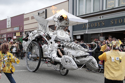 Shaun Walker/The Times-Standard  Bottom Feeders spits fire as it rolls around the Arcata Plaza at the Kinetic Grand Championship on Saturday.