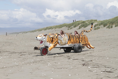 Shaun Walker/The Times-Standard  Sara and Tess Krause of Eureka pedal Tiger and Amazons onto Manila Beach at the Kinetic Grand Championship on Saturday.